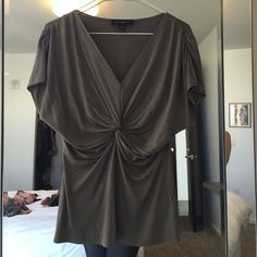 Grey Silk Banana Republic top- small This is a very chic/sexy silk draped grey top from Banana Republic - barely worn without known defects. It's 100% silk  and hand wash cold. Looks amazing with skinny jeans or skirt. Banana Republic Tops Blouses