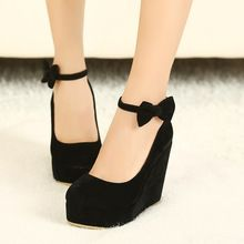 black high-heeled shoes with little bows
