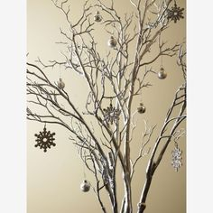 Just get some branches and spray paint them silver, add some foam for a base and a cute pot, then ornaments and WAH-LAH! Christmas decor!