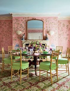 Hand-painted floral wallpaper and a Stark carpet bring a garden atmosphere into the dining room of a Southampton home decorated by Mario Buatta.