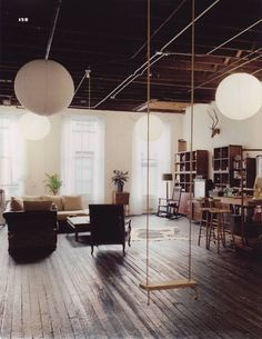 love the swing and the wood, cute vintage loft look!