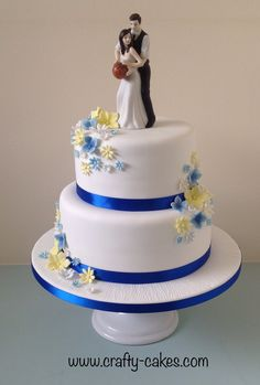 2 tier Wedding Cake basketball topper with royal blue & yellow flowers