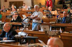State Sen. Ernie Chambers, of Omaha, standing center, follows the vote on his bill abolishing the de... - AP Photo/Nati Harnik