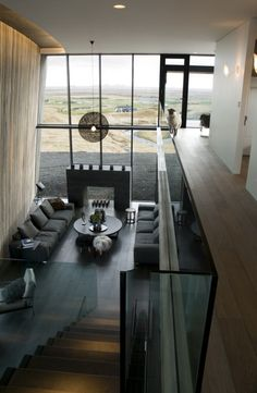 CASA G, image courtesy Gudmundur Jonsson Architects. Minimal yet cosy design. The natural textures echo the landscape visible in the large glazing walls.