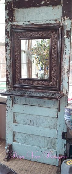 Love the way the mirror is embedded into this old door