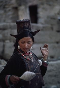 Ladakhi woman spins sheep's wool on a twirling distaff, Ladakh District, India. Photo by Lynn Abercrombie for National Geographic.