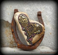 "Mosaic on a heart shaped rock. Beads and tempered glass. 5""x 6""x 2"" Website 