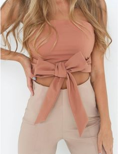 Super cute bow crop top and fitted pants. Add a blazer for the office and take it off for after work drinks | This is How to Master the Crop Top Craze