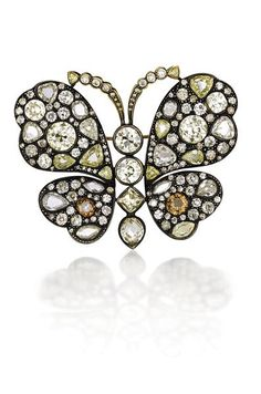 An Impressive Diamond Butterfly Brooch  Designed as an old-cut diamond butterfly, centering upon a collet-set old-cut diamond body, extending vari-cut diamond wings, mounted in silver topped gold, length