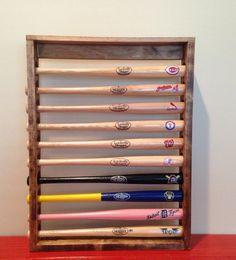 Mini Baseball Bat Display Holder Rack – Table top or wall Mount – Holds 10 Mini Bats by 2Markers on Etsy https://www.etsy.com/listing/267477596/mini-baseball-bat-display-holder-rack
