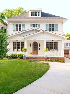 Shutter color Drizzle by Sherwin Williams - Steal inspiring curb appeal ideas from these eye-catching houses featured in HGTV Magazine. Steal inspiring curb appeal ideas from these eye-catching houses featured in HGTV Magazine. Exterior Color Palette, Exterior Paint Colors, Exterior House Colors, Exterior Design, Beige House Exterior, Window Shutters Exterior, Blue Shutters, House Paint Exterior, Shutter Colors