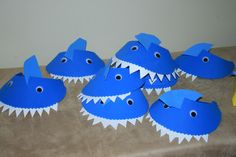"DIY Kids' Craft - Shark visors - hot glue wiggly eyes to front of purchased blue foam visor; cut 1"" slot on top of visor; cut blue foam ""fin"" and insert into slot; cut jagged teeth from white craft foam & glue beneath visor"
