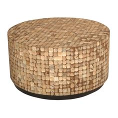 This beautifully crafted round coffee table features natural bliss patina chips placed in an intricate pattern with tan and light brown accents.
