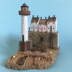 Low tide at the Lighthouse, which is a vintage bobbin. #shabbydaisies #shabbychic #lighthouse #nautical #driftwood #driftwoodart #rustic #rusticart #harbour #handmade#woodenhouse