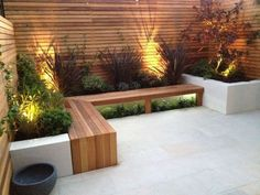 Love the simple lines of the bench and the horizontal planking on the privacy fencing with greenery surround.