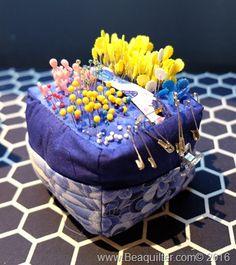 loaded blue pincushion