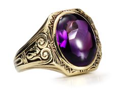 Art Deco Amethyst Ring with a cabochon faceted below while retained the smooth, rounded top. Approx. 7.5 carats, set in 14l yellow gold, made by Jones and Woodland with acanthus leaf details. Circa 1925