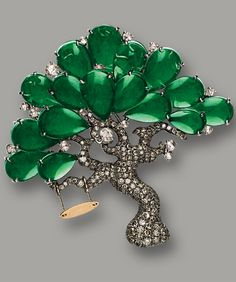 JADEITE AND DIAMOND 'TREE' BROOCH Designed as a tree, the brooch set with pear-shaped jadeites of translucent emerald green colour, decorated with rose- and brilliant-cut diamonds together weighing approximately 3.00 carats, mounted in 18 karat white and pink gold, with pendant fitting. Jadeites approximately 12.35 x 7.83 x 1.70mm to 9.28 x 6.30 x 1.65mm.