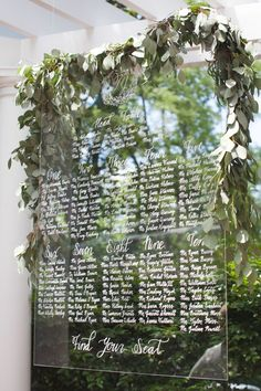 hand calligraphed lucite seating chart dripping with eucalyptus / http://www.himisspuff.com/acrylic-and-lucite-wedding-decor-ideas/