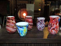 2 Hold on to Hope vases by Dave Porter and leftover frit vases by Rhonda Baker Fireworks Glass Studios