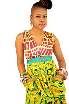 Enhance the African Fashion with this dress made from three different prints and use the fabric scraps to fashion the bracelets.