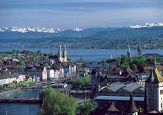 "this is a nice shot of the town ""Zurich"" in Switzerland - in the background you can see the lake zurich and the alps..."