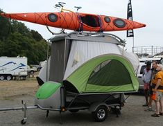 Wow, a tiny pop up with a bike AND a kayak on top