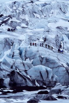 Taken at Iceland's second largest glacier Langjökull. I was based at the foot of the mass of ice taking abstract shots of the patterns running through the frozen mass when a group of friendly hikers passed me. I waited in position watched their cautious ascent up the intimidating glacier. When the hikers reached a prime position I took my shot, emphasising the fact that when man and nature co-operate they create a powerful work of art. (Photographer: Claire Nolan) #Iceland
