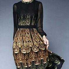 Dress Animal printed dress is loose with long sleeves. Dresses Midi
