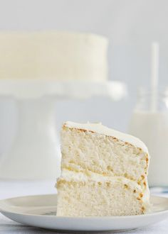"""8640 minutes, 144 hours, 25 loads of dishes, 7 recipes, 8 pounds of butter, a few tears, a couple of happy children, and 1 relieved husband later, I have finally found it: a new favourite classic vanilla cake recipe! The perfect fluffy vanilla cake and creamy vanilla frosting."""