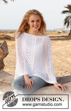 """Knitted DROPS poncho with cables and lace pattern in """"Paris"""". Size: S - XXXL. ~ DROPS Design"""