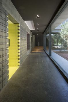 The interiors of this building are arranged around four differently sized courtyards, which are surrounded by glazed walls and planted with trees.