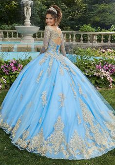 Shop Morilee's Metallic Lace and Glitter Tulle Quinceañera Dress. Glittering quinceañera ballgown featuring crystal beading and metallic lace on glitter tulle with long sleeves. Comes with matching stole. Light Blue Quinceanera Dresses, Long Sleeve Quinceanera Dresses, Mexican Quinceanera Dresses, Mexican Dresses, Wedding Dresses, Quinceanera Party, Sweet 15 Dresses, Pretty Dresses, Beautiful Dresses