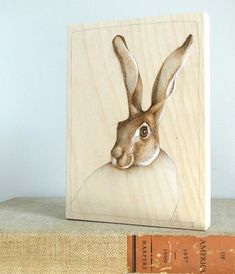 Nice woodburned piece with a rabbit.