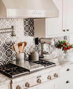 This kitchen backsplash is amazing. Black and White Tile.