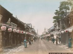 8890's, Yokohama. Festival lanterns cheer up the business district of Bentendori 2-chome and 3-chome in Yokohama. During the Meiji Period (1868-1912), this was Yokohama's premier shopping street. Foreign visitors came here to buy porcelain, curios, ivory, silk and photographs. The photographer of this very image, Kimbei Kusakabe, actually had a studio on this street between 1881 and 1889.