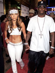 Jennifer Lopez in Sean John and Puff Daddy at MTV Video Music Awards 2000 Radio City Music Hall on September 2000 2000s Fashion Trends, Early 2000s Fashion, Jennifer Lopez, Hip Hop Fashion, 90s Fashion, Fashion Outfits, Stylish Outfits, Britney Spears, 00s Mode