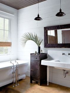 Modern industrial bathroom with free-standing bathtub in John Mellencamp's South Carolina home tour on Thou Swell @thouswellblog