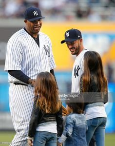 Soccer player David Villa of NYCFC introduces his kids to pitcher CC Sabathia #52 of the New York Yankees, before he throws out the first pitch before a game between the Toronto Blue Jays at Yankee Stadium on May 3, 2017 in New York City.
