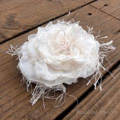 Vintage style flower using sheer synthetic fabric, eyelash yarn & a stapler!