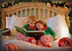 Maybe Aaron & I reading Ivan a Christmas book in Christmas PJs sitting in front of the decorated tree!