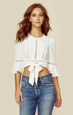 The For Love and Lemons Willow Crop Top features three quarter length bell sleeves, front waist tie, flower trim detail, and tiny ladder cutouts throughout. Boho Fashion, Fashion Dresses, Womens Fashion, Fashion Design, Fashion Clothes, Casual Outfits, Cute Outfits, Diy Vetement, Look Chic