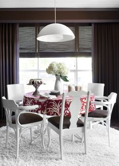 mismatched chairs, sprayed them all white, updated their seat cushions with brown linen, then contrasted the brown and white with a red/white chinoiserie table skirt.