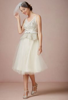 "Brides.com: Wedding Dresses We Love For Under $1,000. A peplum is not only super on-trend, its retro shape covers up any problem areas (in the chicest way possible!).  ""Clara"" wedding dress, $500, Quilaree exclusively available at BHLDN  See more BHLDN wedding dresses."