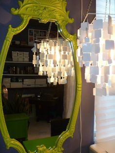 such a cool homemade chandelier in this uber- organized craft space. I could handle that.