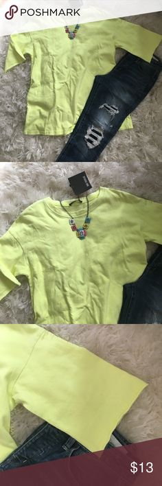 Zara Trafaluc neon tee NWT make a statement in their neon short sleeve tee. Perfect for the beach or to wear with your favorite destroyed Denim. Size Small from Zara. No flaws. Smoke and pet free home. Zara Tops Tees - Short Sleeve