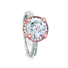 HAMILTON/ROUND engagement ring named after the Scottish town of Hamilton. Stunning modern design featuring split-level leaf-shaped prongs for a brilliant-cut center stone, framed by channel-set halo-style accent diamonds.