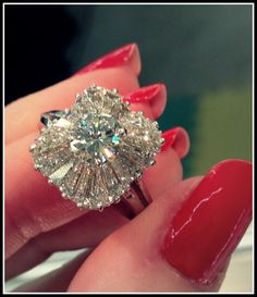 1930's ballerina-style diamond engagement ring. Via Diamonds in the Library.