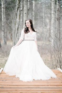Champagne + Linen event and wedding planners based out of Missoula, Montana put on a vintage, pink, spring styled shoot. The beautiful, fun loving bride was twirling in the woods in her Lorelei by Leanne Marshall gown.