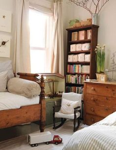Antique wood furniture makes for sturdy furnishing for a kid's room. Bits of nostalgia, like a child sized antique chair and vintage toys complete a kid friendly design.